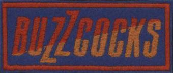 BUZZCOCKS - Oranžovo - červené logo na modrom podklade