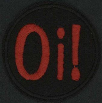 OI! - Červené logo na čiernom podklade.
